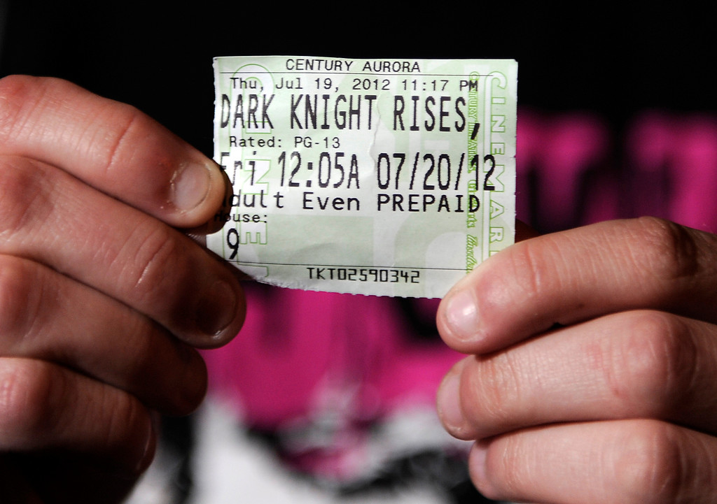 . Brittany Diemer shows the ticket stub for the Dark Knight Rises. She was in the theatre when a gunmen opened fire on moviegoers. Aurora Police responded to the Century 16 movie theatre early Friday morning, July 20, 2012. Karl Gehring/The Denver Post