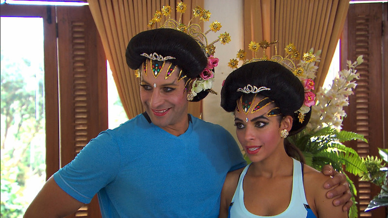 """. \""""Cobra in my Teeth\""""-- In Detour A, Dating couple Jason (left) and Amy (right) must make each other up as a traditional Javanese bride in order to receive the next clue on THE AMAZING RACE, Sunday, Dec 1 (8:00-9:00 PM, ET/PT) on the CBS Television Network. Photo: CBS©2013 CBS Broadcasting, Inc. All Rights Reserved"""