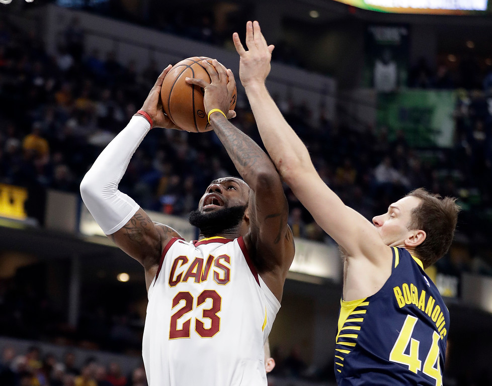 . Cleveland Cavaliers\' LeBron James (23) shoots against Indiana Pacers\' Bojan Bogdanovic during the first half of an NBA basketball game, Friday, Jan. 12, 2018, in Indianapolis. (AP Photo/Darron Cummings)