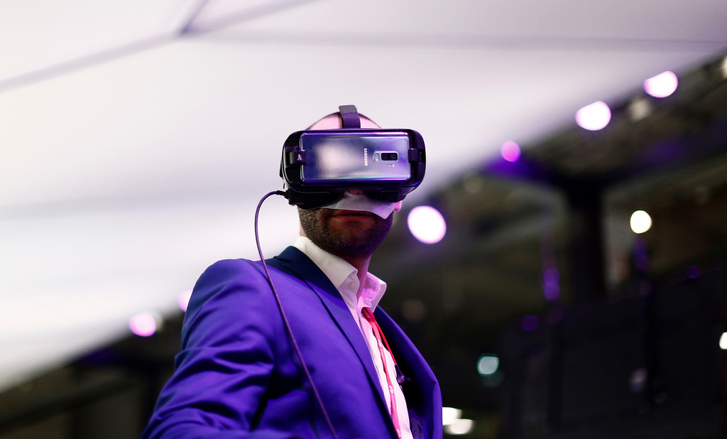 . A visitors uses a VR gear installed on a new Samsung Galaxy S9 mobile phone during the Mobile World Congress wireless show, in Barcelona, Spain, Tuesday, Feb. 27, 2018. The annual Mobile World Congress (MWC) runs from 26 February - 1 March and draws over 2,300 exhibitors to Barcelona, including industry heavyweights Samsung, Huawei and Nokia. (AP Photo/Manu Fernandez)