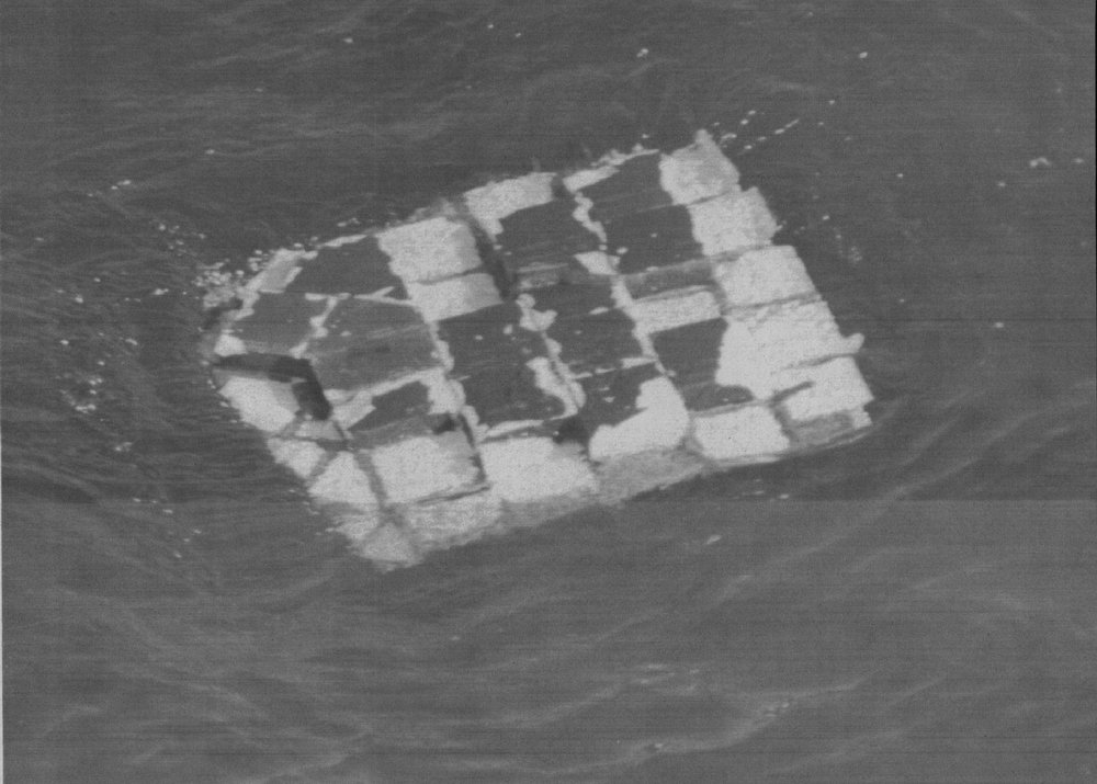 Description of . A large section of the fuselage measuring about 4-ft-by-6-ft floats in the Atlantic about 55 miles southeast of Daytona Beach, Fla. on Jan. 31, 1986. The heat-shielding tiles that protect the shuttle upon re-entry can easily been seen. Denver Post Library Archive