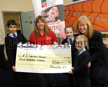Pupils of Windsor Hill PS presented £400 to the NI Childrens Hospice, pictured lto r.Devaa Kamath,Dorothy Cooke, (Childrens Hospice),Melissa Johnston,Harry Sutton, Heather Irvine,(Principle). 07W6N19