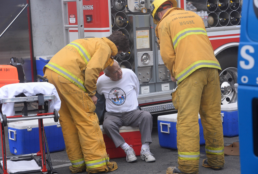 . Elks Lodge fire in San Pedro. LAFD firefighters aid Matty Domancich, 91, at the scene of the fire. He was the Exalted Ruler of the lodge in the 60\'s and 70\'s. (April 15, 2014. Photo by Brad Graverson/The Daily Breeze)