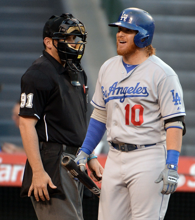 . Los Angeles Dodgers\' Justin Turner (10) reacts after striking out as home plate Brian Knight (91) looks on in the first inning of a baseball game at Anaheim Stadium in Anaheim, Calif., on Thursday, Aug. 7, 2014.  (Photo by Keith Birmingham/ Pasadena Star-News)