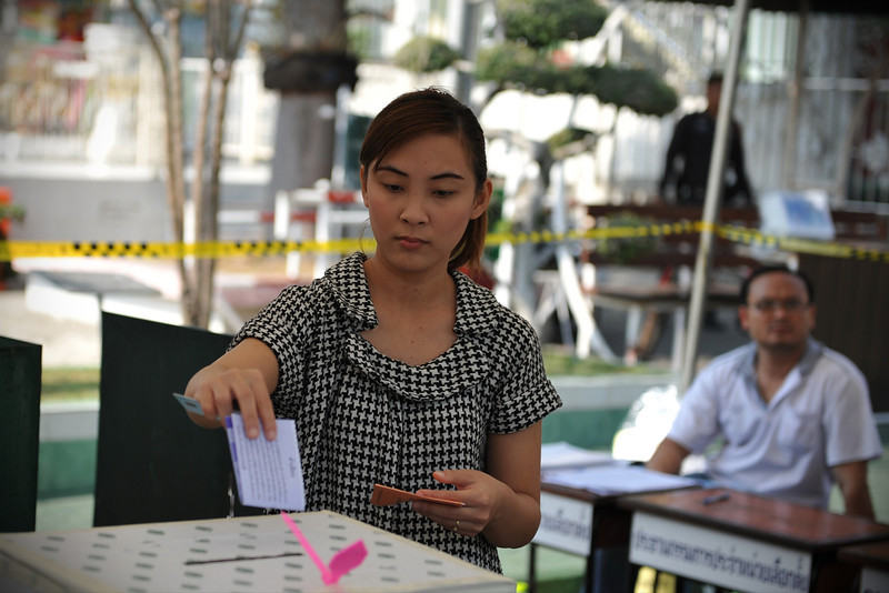 . A woman casts a vote at a polling station in Thailand\'s general election on February 2, 2014 in Bangkok, Thailand. Anti - government protesters took over government buildings where ballot boxes were stored as an attempt to derail the elections. Bangkok Shutdown has been in effect for over two weeks as the anti-government protesters continue to block major intersections. The Thai government imposed a 60-day state of emergency in Bangkok and the surrounding provinces in an attempt to cope with the on-going political turmoil however this decree has had no effect on the mass protests.  (Photo by Rufus Cox/Getty Images)