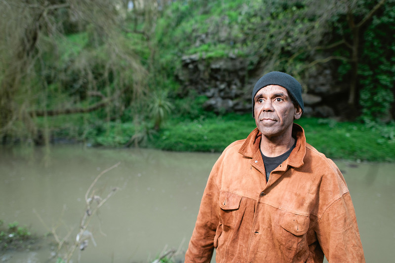 Indigenous Australian Man with a River in the Background