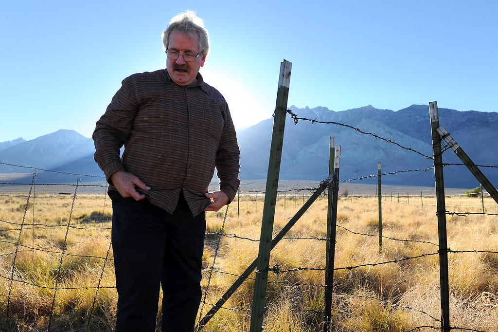 . Botanist Mark Bagley, a member of the Sierra Club, talks about how the water table effects the grass and shrub growth in the Owens Valley. (Photo by Michael Owen Baker/L.A. Daily News)