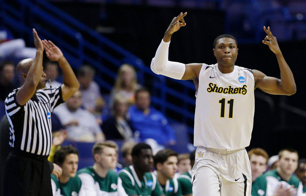 . Wichita State forward Cleanthony Early (11) celebrates his three-point basket against Cal Poly during the first half of a second-round game in the NCAA college basketball tournament Friday, March 21, 2014, in St. Louis. (AP Photo/Jeff Roberson)