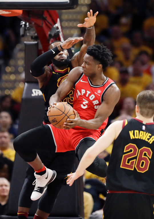 . Toronto Raptors\' OG Anunoby (3), from England, goes up for a shot against Cleveland Cavaliers\' LeBron James and Kyle Korver(26) in the first half of Game 4 of an NBA basketball second-round playoff series, Monday, May 7, 2018, in Cleveland. (AP Photo/Tony Dejak)