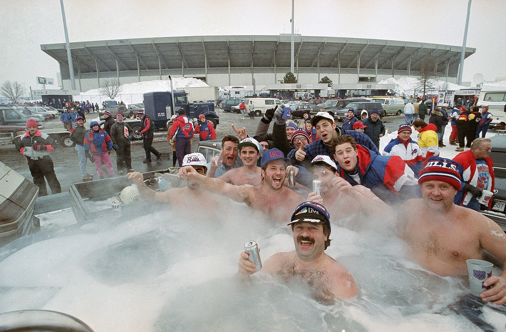. Buffalo Bills fans cheer on their team from a portable hot tub in the parking lot at Rich Stadium before the start of the AFC Championship game, Sunday, Jan. 23, 1994 in Orchard Park, N.Y. The Bills Play the Kansas City Chiefs for the championship. (AP Photo/Bill Sikes)