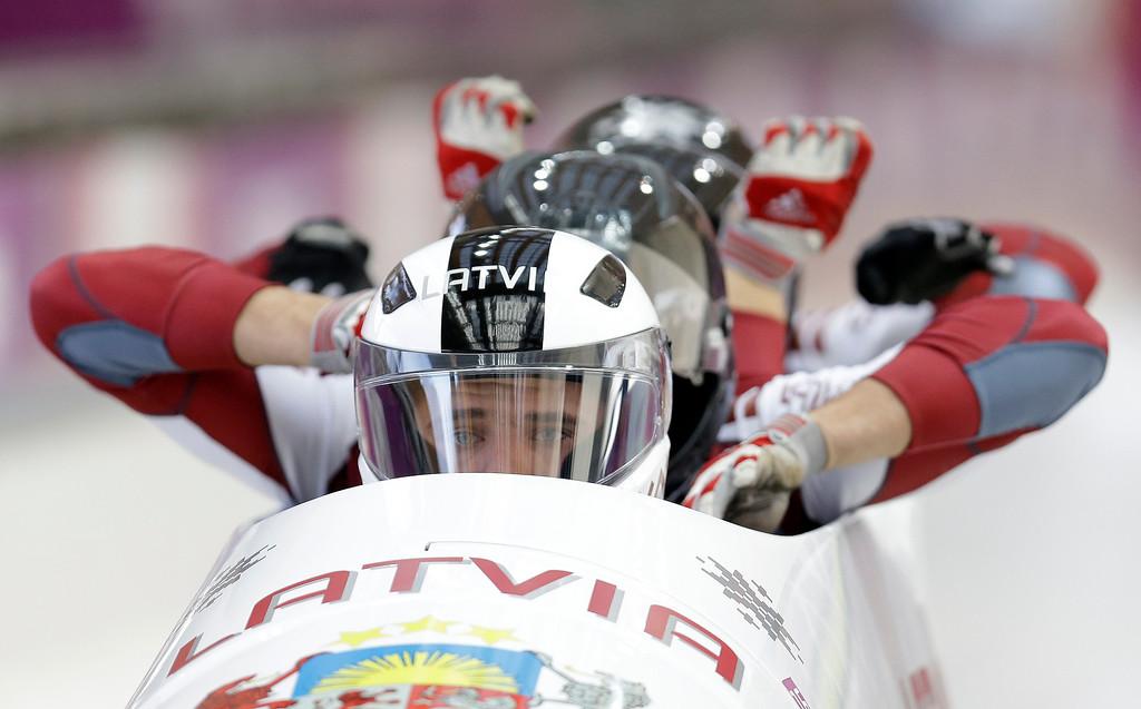 . The team from Latvia LAT-2, with Oskars Kibermanis, Raivis Broks, Helvijs Lusis and Vairis Leiboms, start their third run during the men\'s four-man bobsled competition final at the 2014 Winter Olympics, Sunday, Feb. 23, 2014, in Krasnaya Polyana, Russia. (AP Photo/Natacha Pisarenko)