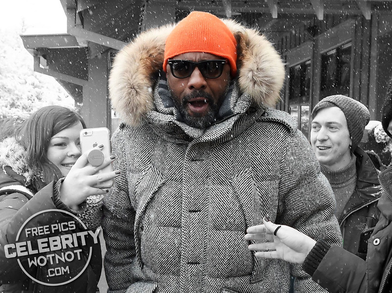 Idris Elba Wears A Bright Orange Beanie And Burberry Parka in Park City, Utah