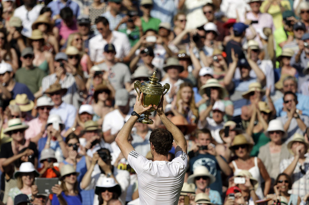 . Britain\'s Andy Murray holds the winner\'s trophy during the presentation after beating Serbia\'s Novak Djokovic in the men\'s singles final on day thirteen of the 2013 Wimbledon Championships tennis tournament at the All England Club in Wimbledon, southwest London, on July 7, 2013. Murray won 6-4, 7-5, 6-4.  ANJA NIEDRINGHAUS/AFP/Getty Images