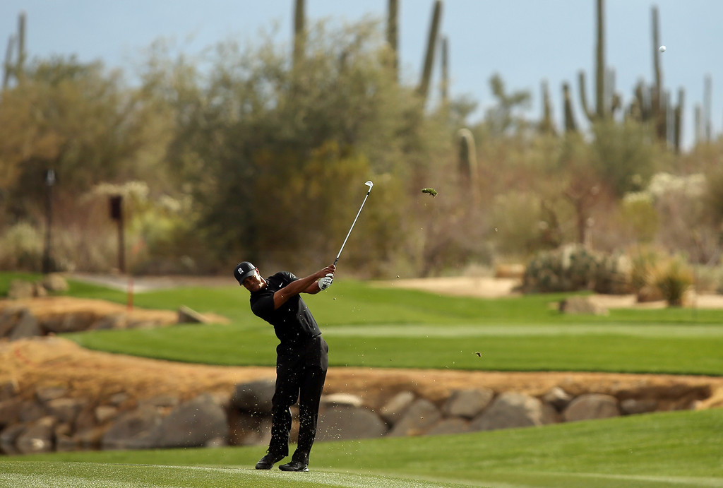 . MARANA, AZ - FEBRUARY 21:  Tiger Woods hits a shot from the fairway on the fourth hole during the first round of the World Golf Championships - Accenture Match Play at the Golf Club at Dove Mountain on February 21, 2013 in Marana, Arizona. Round one play was suspended on February 20 due to inclimate weather and is scheduled to be continued today.  (Photo by Darren Carroll/Getty Images)