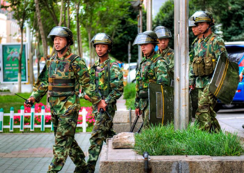 In Full Force. Chinese Police in Urumqi.  http://sillymonkeyphoto.com/2010/09/20/urumqi-street-police/