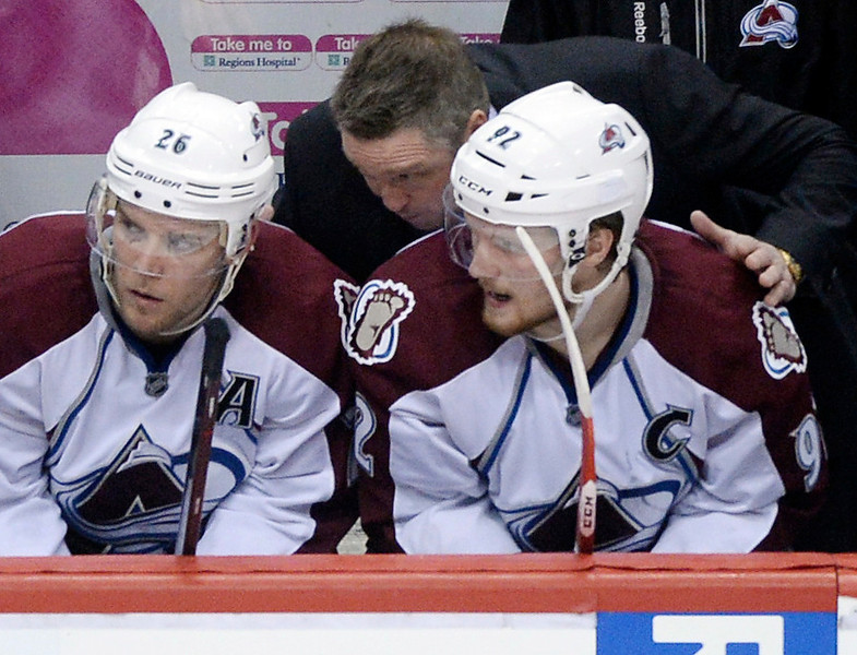 . Avalanche coach Patrick Roy shared his thoughts with Paul Stastny, left, and Gabe Landeskog, right, in the second period. (Photo by Karl Gehring/The Denver Post)