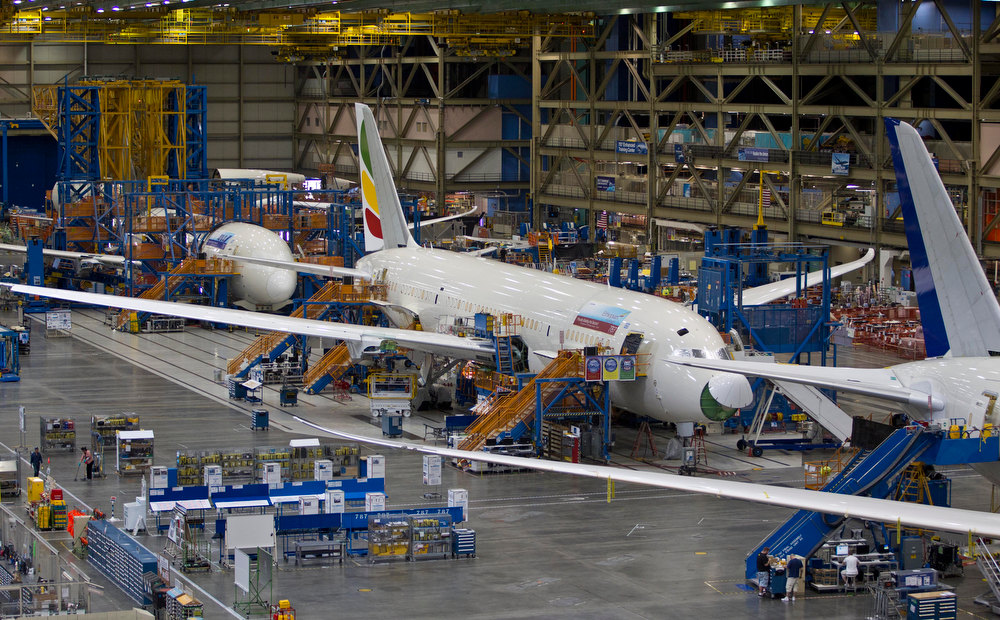 Description of . In this Sept. 25, 2011 file photo, Boeing 787s sit at the company's assembly plant in Everett, Wash. The U.S. Federal Aviation Administration announced Friday, Jan. 11, 2013 that the agency is conducting a comprehensive review of the design, manufacture and assembly of the Boeing 787, even while government officials declared the plane safe despite recent incidents including a fire and a fuel leak earlier this week. (AP Photo/John Froschauer, File)