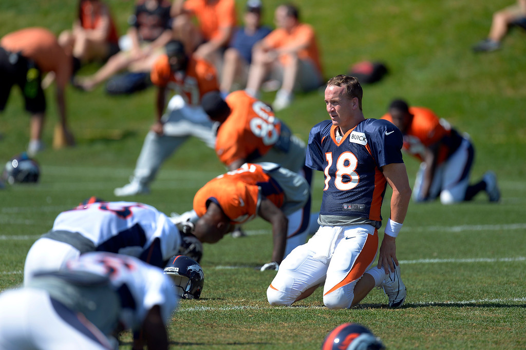 . Denver Broncos quarterback Peyton Manning (18) stretches during practice August 20, 2013 at Dove Valley (Photo by John Leyba/The Denver Post)