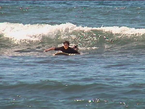 Jax paddling into wave.jpg