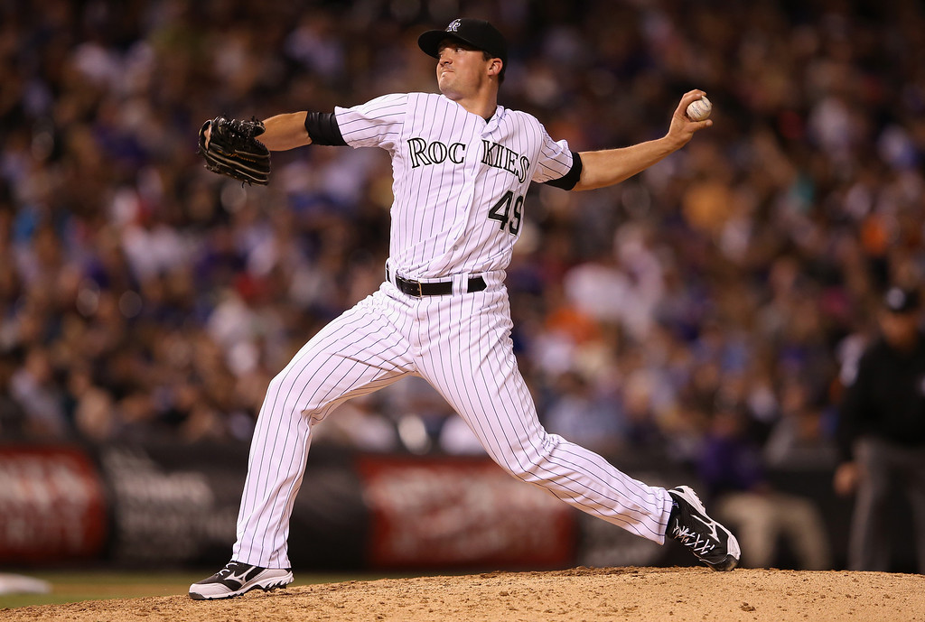 . DENVER, CO - MAY 03:  Relief pitcher Rex Brothers #49 of the Colorado Rockies delivers against the New York Mets at Coors Field on May 3, 2014 in Denver, Colorado.  (Photo by Doug Pensinger/Getty Images)