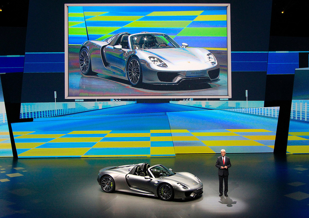 . Porsche AG CEO Matthias Mueller presents the new Porsche 918 Spyder during a preview by the Volkswagen Group prior to the 65th Frankfurt Auto Show in Frankfurt, Germany, Monday, Sept. 9, 2013. More than 1,000 exhibitors will show their products to the public from Sept. 12 through Sept. 22, 2013. (AP Photo/Frank Augstein)