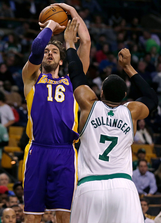 . Los Angeles Lakers center Pau Gasol (16) shoots over Boston Celtics power forward Jared Sullinger (7) during the second half of an NBA basketball game in Boston, Friday, Jan. 17, 2014. The Lakers won 107-104. (AP Photo/Charles Krupa)