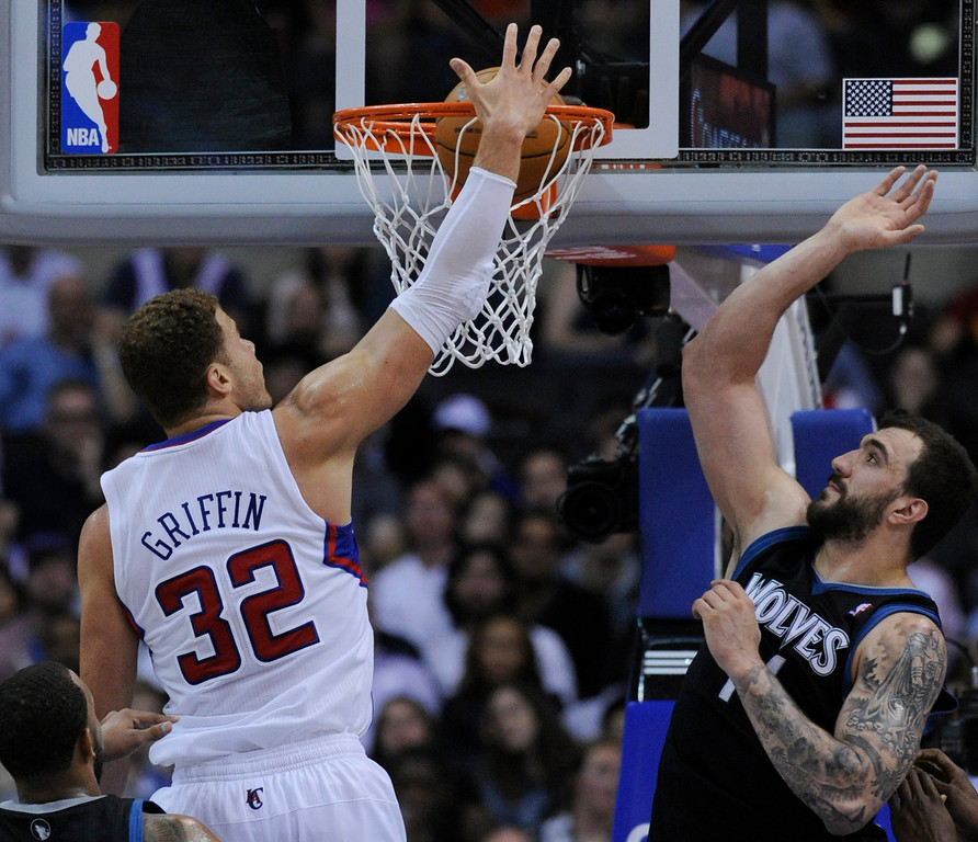 . Clippers#32 Blake Griffin tips in a basket against Timberwolves#47 Andrei Kirilenko in the 4th quarter. The Clippers defeated the Minnesota Timberwolves 111-95 in a game played at Staples Center in Los Angeles, CA 4/10/2013(John McCoy/Staff Photographer