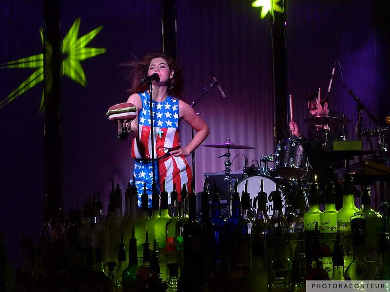 "Marina & The Diamonds performing at the Book & Stage within The Cosmopolitan of Las Vegas on April 8, 2011.  She wore this American flag outfit and presented a stuffed hamburger to the crowd as she performed the last song of the show - ""Hollywood"".