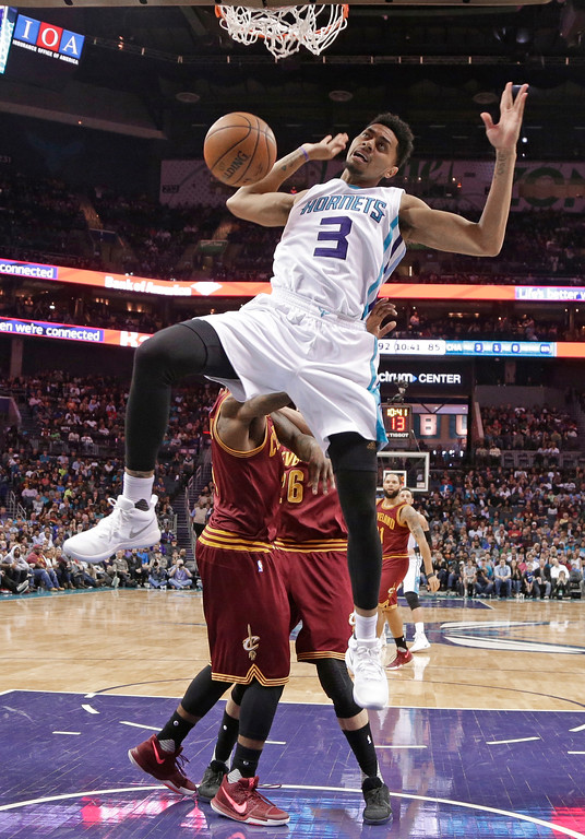 . Charlotte Hornets\' Jeremy Lamb (3) dunks against the Cleveland Cavaliers during the second half of an NBA basketball game in Charlotte, N.C., Friday, March 24, 2017. The Cavaliers won 112-105. (AP Photo/Chuck Burton)