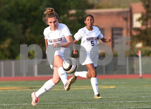 10/13/17 Wesley Bunnell | Staff Bulkeley vs New Britain girls soccer at Veterans' Stadium on Friday afternoon. Adriana Martenuz (4) and Kiara Matias (5).