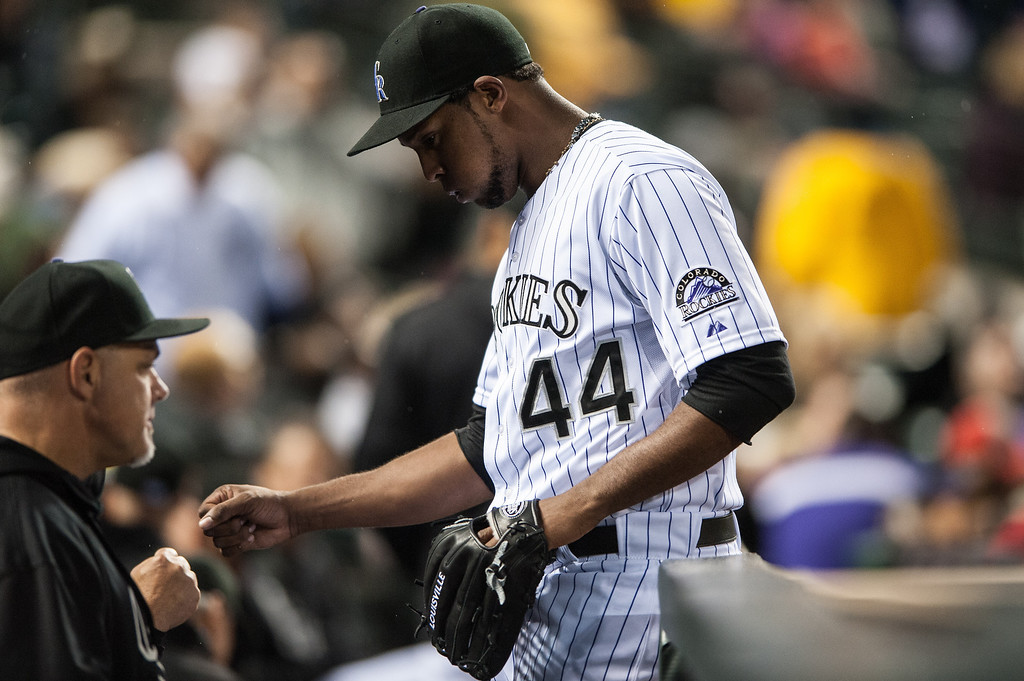 . Juan Nicasio #44 of the Colorado Rockies is congratulated after the top of the fifth inning of a game against the New York Yankees at Coors Field on May 8, 2013 in Denver, Colorado.  (Photo by Dustin Bradford/Getty Images)