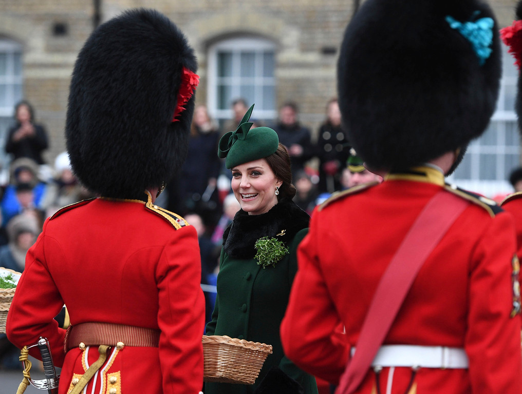 . Britain\'s Kate, the Duchess of Cambridge, smiles as she and Prince William visit the 1st Battalion Irish Guards, for the St. Patrick\'s Day Parade, at Cavalry Barracks, in Hounslow, England, Saturday, March 17, 2018.  (Andrew Parsons/Pool Photo via AP)