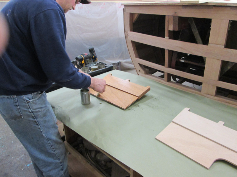 Epoxy being applied to the ski rack.