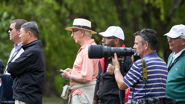 RWGC member Maurice Clark (with cell phone) watching the action on the 9th green on the  final day of the Asia-Pacific Amateur Championship tournament 2017 held at Royal Wellington Golf Club, in Heretaunga, Upper Hutt, New Zealand from 26 - 29 October 2017. Copyright John Mathews 2017.   www.megasportmedia.co.nz