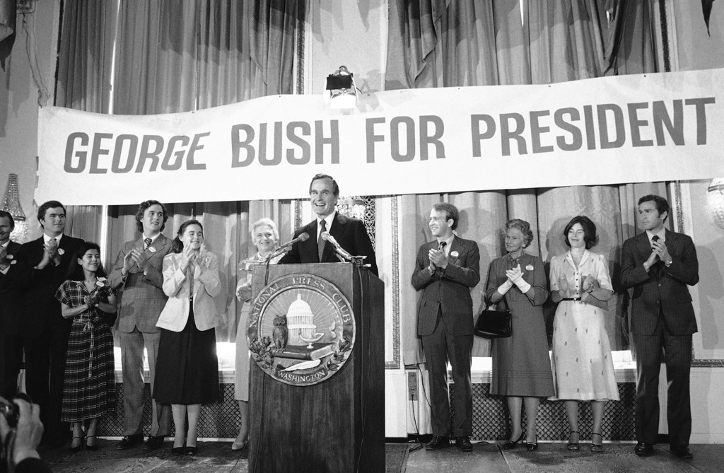 . George Bush beams as some of his family members applaud at the National Press Club in Washington on Tuesday, May 1, 1979 where he formally announced his candidacy for the Republican presidential nomination. From left are: John E. (Jeb), a son; Columba, a daughter-in-law; Marvin, a son; Dorothy, a daughter; Mrs. Barbara Bush, his wife; and Bush. (AP Photo/Taylor)