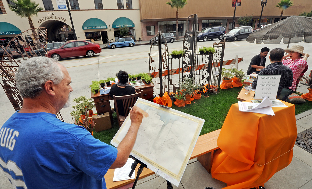 . Pete Morris of Temple City painting a city landscape in watercolors during PARKday, in front of Vroman\'s book store. On Friday, September 20th on Colorado Boulevard in the  Pasadena�s Playhouse District celebrated international PARK(ing) Day by transforming two parking spaces into temporary parklets. Pasadena is the first city in San Gabriel Valley to participate in this worldwide grassroots event.(Photo by Walt Mancini/Pasadena Star-News)