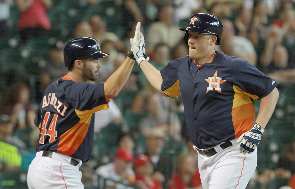 . HOUSTON, TX- SEPTEMBER 15: Marc Krauss #59 high fives Matt Pagnozzi #44 of the Houston Astros after hitting a solo home run off of Jerome Williams #57 of the Los Angeles Angels of Anaheim in the second inning on September 15, 2013 at Minute Maid Park in Houston, Texas. (Photo by Thomas B. Shea/Getty Images)