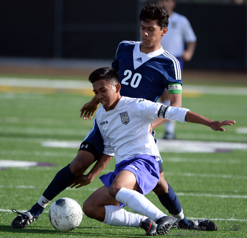 . Diamond Bar\'s Kyleo Torres (C) fights for the loose ball with Baldwin Park\'s Danny Vega (20) in the first half of a CIF-SS quarterfinal prep playoff soccer match at Diamond Bar High School in Diamond Bar, Calif., on Thursday, Feb.27, 2014. Baldwin Park won 2-1. (Keith Birmingham Pasadena Star-News)