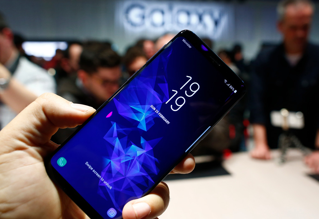 . The new Galaxy S9+ is displayed during the Samsung Galaxy Unpacked 2018 event on the eve of the Mobile World Congress wireless show, in Barcelona, Spain, Sunday, Feb. 25, 2018. Samsung unveiled new smartphones with largely unchanged designs and incremental improvements such as a better camera. (AP Photo/Manu Fernandez)