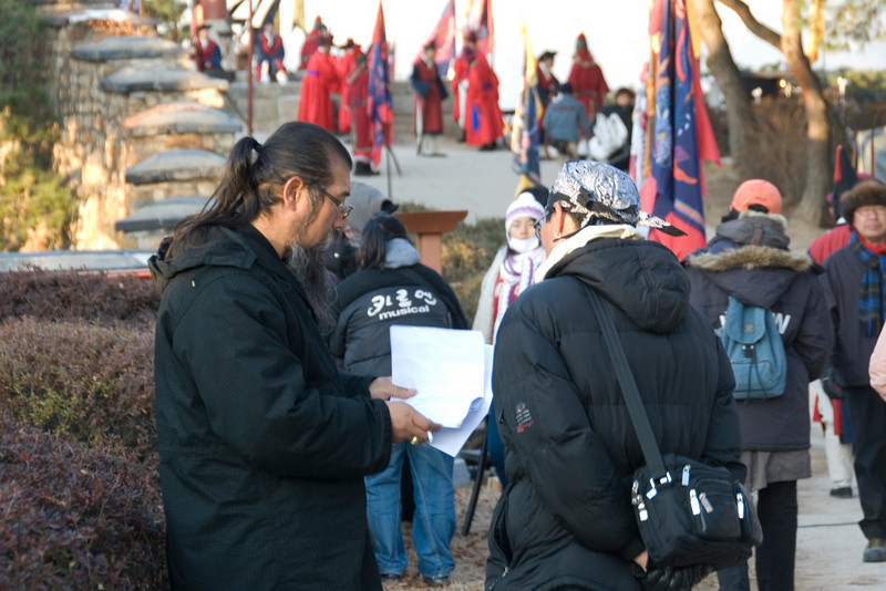 Director and crew during filming at Hwaseong Fortress - South Korea
