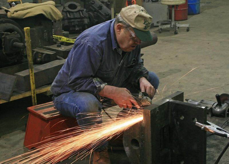 Volunteer grinding.jpg