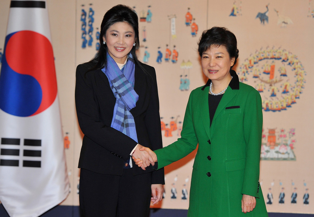 . South Korea\'s incoming president Park Geun-Hye (R) shakes hands with Thai Prime Minister Yingluck Shinawatra at the presidential Blue House in Seoul on February 25, 2013. AFP PHOTO / POOL / KIM JAE-HWANKIM JAE-HWAN/AFP/Getty Images