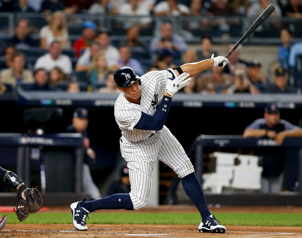 . New York Yankees\' Aaron Judge strikes out swinging against the Cleveland Indians during the first inning in Game 3 of baseball\'s American League Division Series, Sunday, Oct. 8, 2017, in New York. (AP Photo/Kathy Willens)