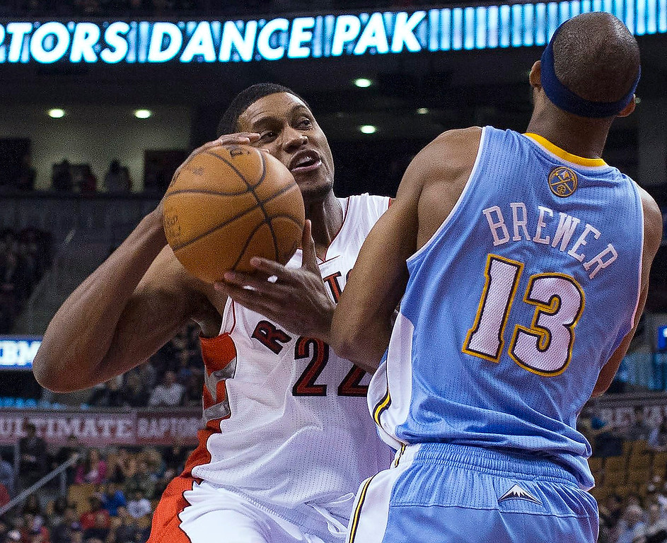 . Toronto Raptors\' Rudy Gay, left, fouls Denver Nuggets\' Corey Brewer during the first half of an NBA basketball game in Toronto on Tuesday, Feb. 12, 2013. (AP Photo/The Canadian Press, Chris Young)