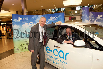 Minister Danny Kennedy is pictured at the E-car roadshow held in the Quays with Mayor Mickey Ruane. R1410002