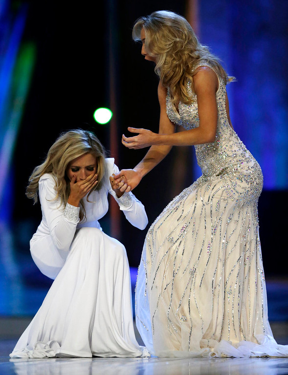 . Miss New York Kira Kazantsev, left, celebrates after she was named Miss America 2015 as she holds hands with Miss Virginia Courtney Paige Garrett during the Miss America 2015 pageant, Sunday, Sept. 14, 2014, in Atlantic City, N.J. (AP Photo/Julio Cortez)