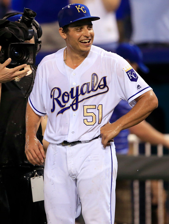 . Kansas City Royals starting pitcher Jason Vargas waits for an interview after being doused by teammate Salvador Perez following a baseball game against the Cleveland Indians at Kauffman Stadium in Kansas City, Mo., Friday, June 2, 2017. The Royals won 4-0. (AP Photo/Orlin Wagner)