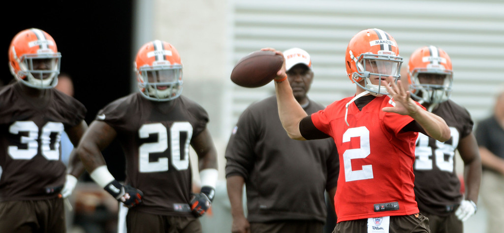 . Maribeth Joeright/MJoeright@News-Herald.com <p> Browns quarterback Johnny Manziel throws  during the first day of mini camp in Berea, June 10, 2014.