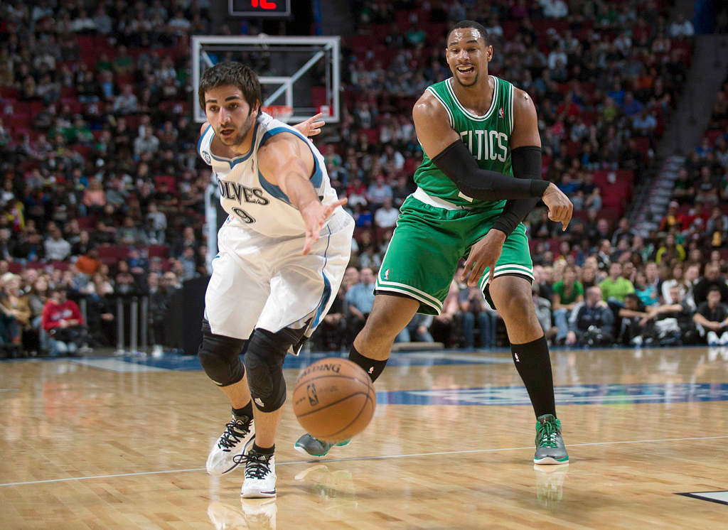 . Boston Celtics\' Jared Sullinger, right, makes a pass as Minnesota Timberwolves\' Ricky Rubio defends during first quarter.  (AP Photo/The Canadian Press, Graham Hughes)