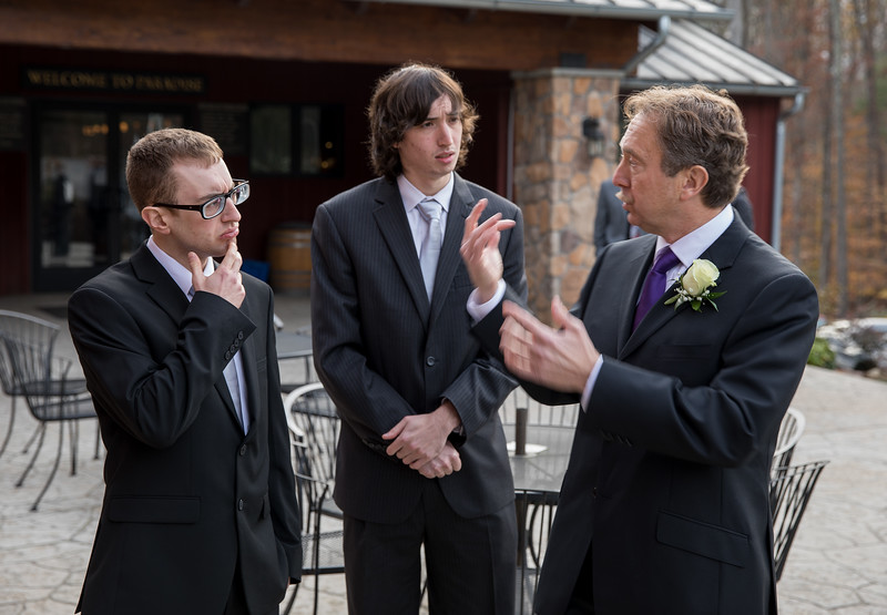 Groom going over itinerary with sons.jpg